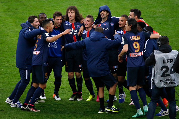 Paris Saint-Germain's players jubilate at the end of the French League Cup final football match between Paris Saint-Germain and Lille on April 23, 2016 at the Stade de France in Saint-Denis, north of Paris. AFP PHOTO / THOMAS SAMSON / AFP / THOMAS SAMSON (Photo credit should read THOMAS SAMSON/AFP/Getty Images)