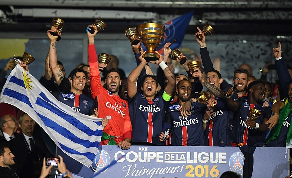 Paris Saint-Germain's players celebrate with the trophy after winning the French League Cup final football match against Lille on April 23, 2016 at the Stade de France in Saint-Denis, north of Paris. AFP PHOTO / FRANCK FIFE / AFP / FRANCK FIFE (Photo credit should read FRANCK FIFE/AFP/Getty Images)
