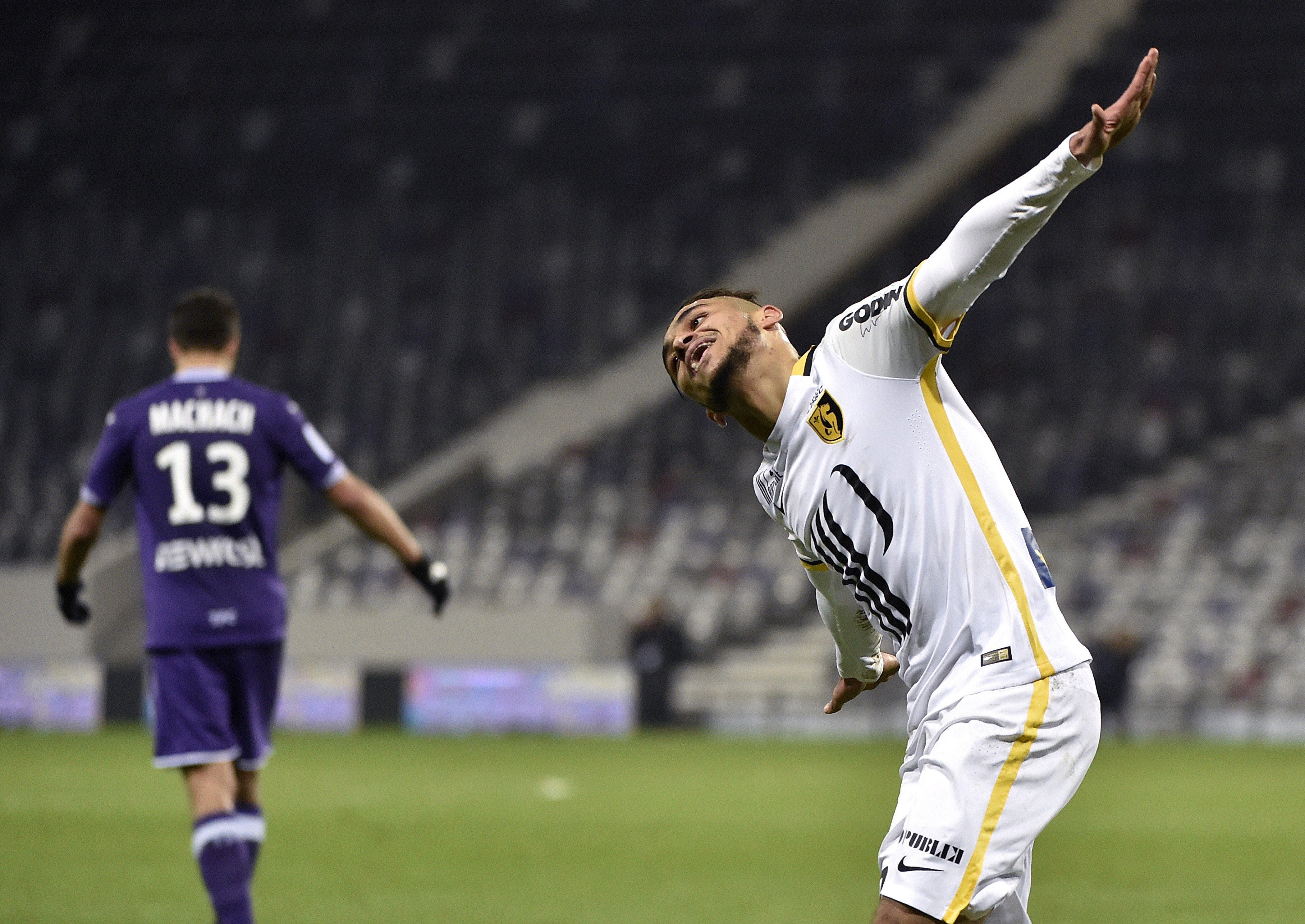 Lille's French midfielder Sofiane Boufal celebrates after scoring a goal during the French L1 football match between Toulouse (TFC) and Lille (LOSC) on December 19, 2015 at the Municipal Stadium in Toulouse, southern france. AFP PHOTO / PASCAL PAVANI / AFP / PASCAL PAVANI (Photo credit should read PASCAL PAVANI/AFP/Getty Images)